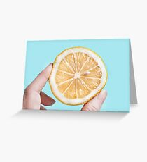 Juicy lemon on a blue background Greeting Card