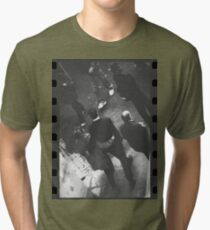 Couple walking in street black and white analog 35mm film photo Tri-blend T-Shirt