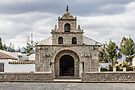 Stone block church facade, Colta, Ecuador by Kendall Anderson