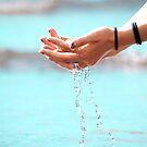 Water through hands by Arve Bettum