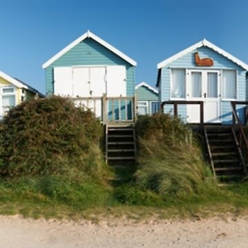 Panoramic view of beach huts in Dorset, England by adrianbrockwell