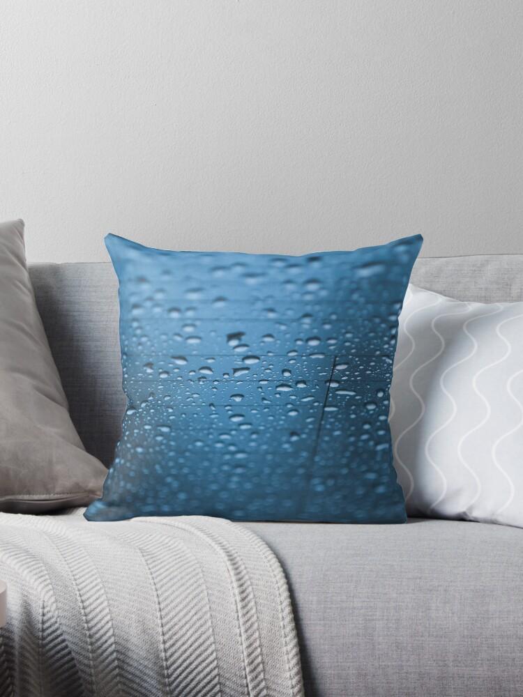 Water rain drop on car rear glass, raining, moisture, wet theme, blue color tone. by Mariia Kalinichenko