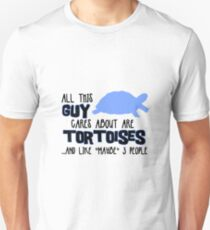 All this guy cares about are tortoises... (Black & Blue) T-Shirt