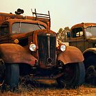 Trucks Under Smoke - Perris, CA by Larry Costales