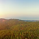 Aerial view of sunset over mountain jungle by Lukasz Szczepanski