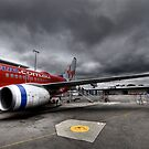 Stormy Departure - Sydney Airport, Australia. by Leigh Nelson
