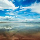 Reflections in the water at Saunton sands, Devon by Victoria Ashman