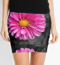 Bright pink flower with black background Mini Skirt