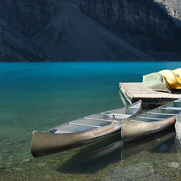 Canoes on Moraine Lake by buzzword