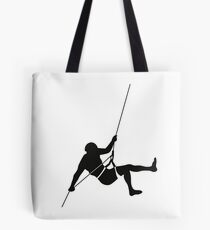 Climber climbing on the wall hill Tote Bag