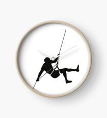 Climber climbing on the wall hill Clock