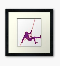 Climber climbing on the wall hill in purple Framed Print