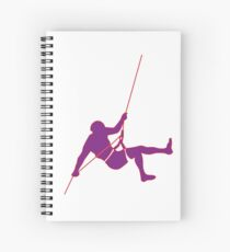 Climber climbing on the wall hill in purple Spiral Notebook
