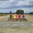 Four colourful mailboxes by David Smith