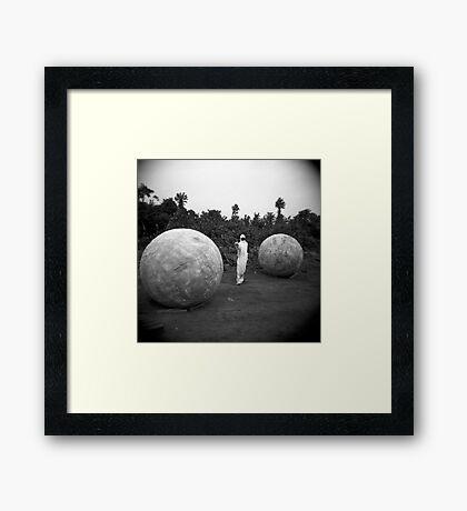 Between balls Framed Print