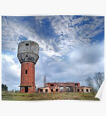 ruins of old water-tower on autumn landscape Poster