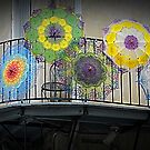 colourful umbrellas, Bourbon Street balcony, French Quarter Festival, New Orleans, USA by David Carton