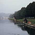 Fishermen on Grand Canal Fontainbleu France 19840829 0001  by Fred Mitchell