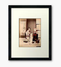 Geisha writing a letter Framed Print