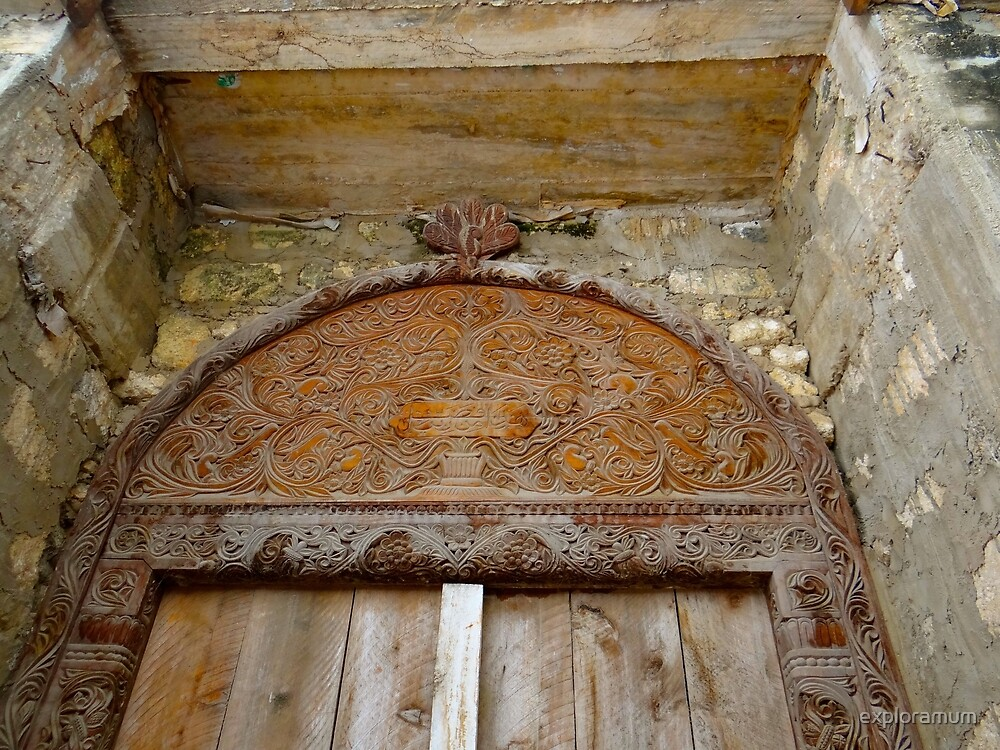 Old Lamu Town - carved old door by exploramum