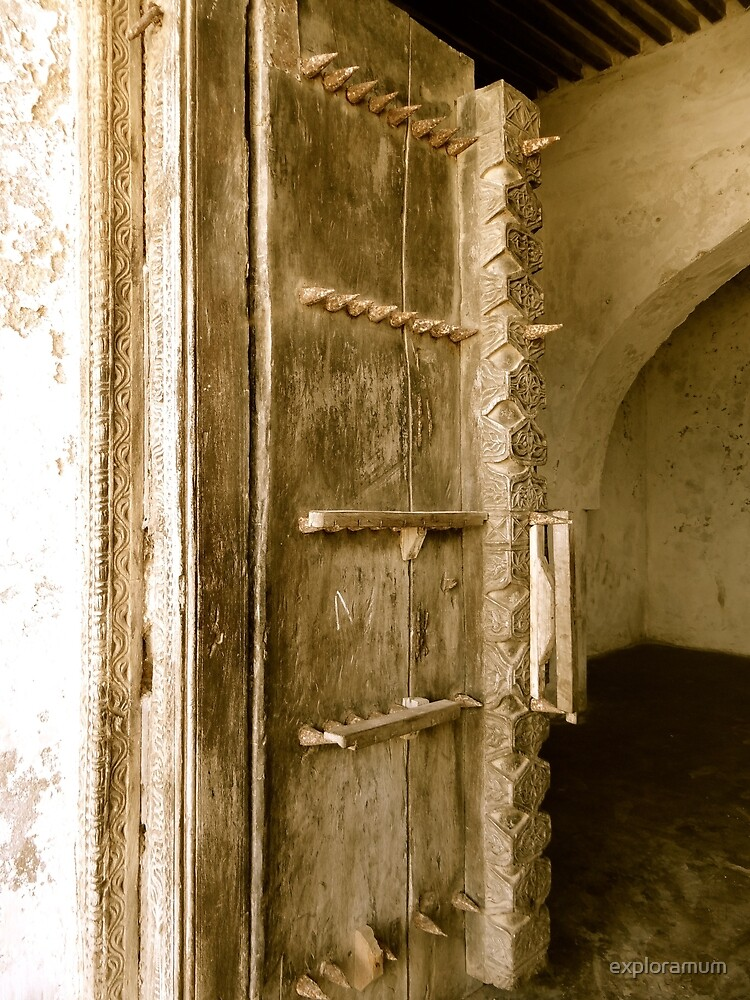 Old Lamu Town - carved old door with spikes by exploramum