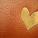 Metal heart on leather by cocodesigns