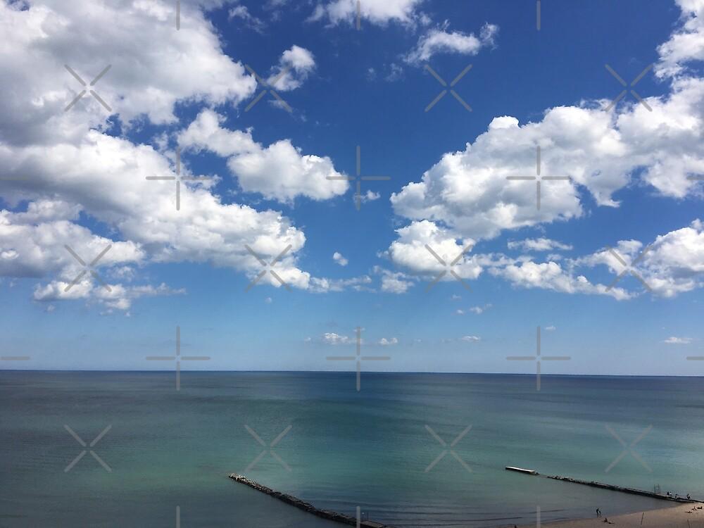 Clouds beach ocean pier by Ryan Biddle