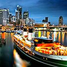 Darling Harbour by night by Throwing  Buckets Magazine