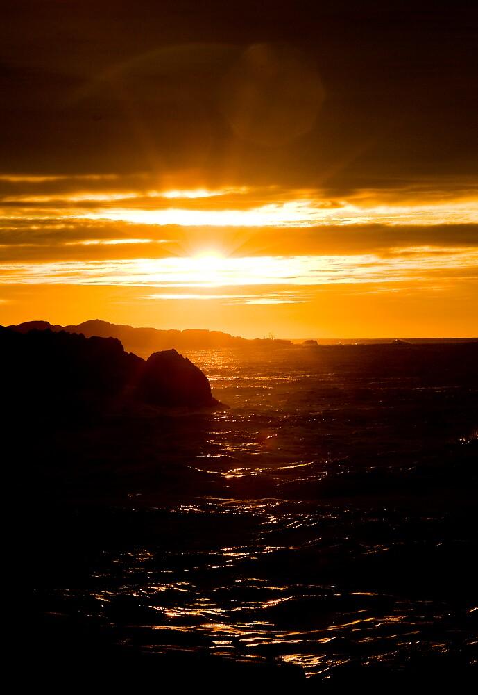 Norwegian sunrise by the rocky shores by Vegard Giskehaug