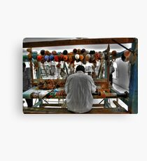 Working the Loom Canvas Print