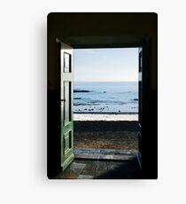 Ocean trough the door Canvas Print