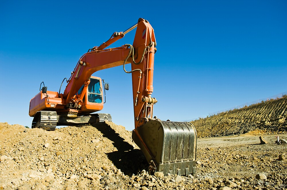 Excavator in a road construction by mrfotos