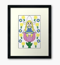 Sitting In The Tulips Framed Print