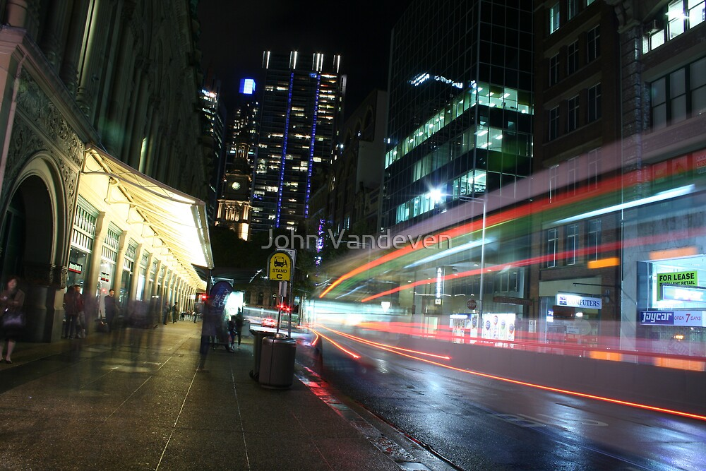 Catching the bus by John Vandeven