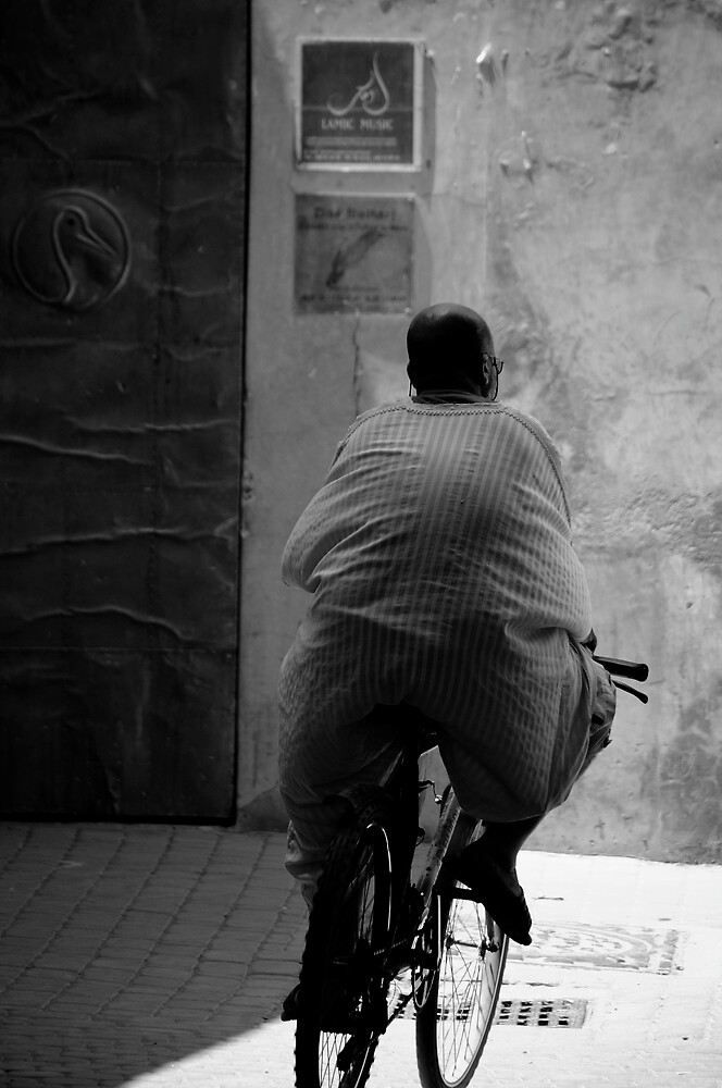 boy on bike by Rob Blackwood
