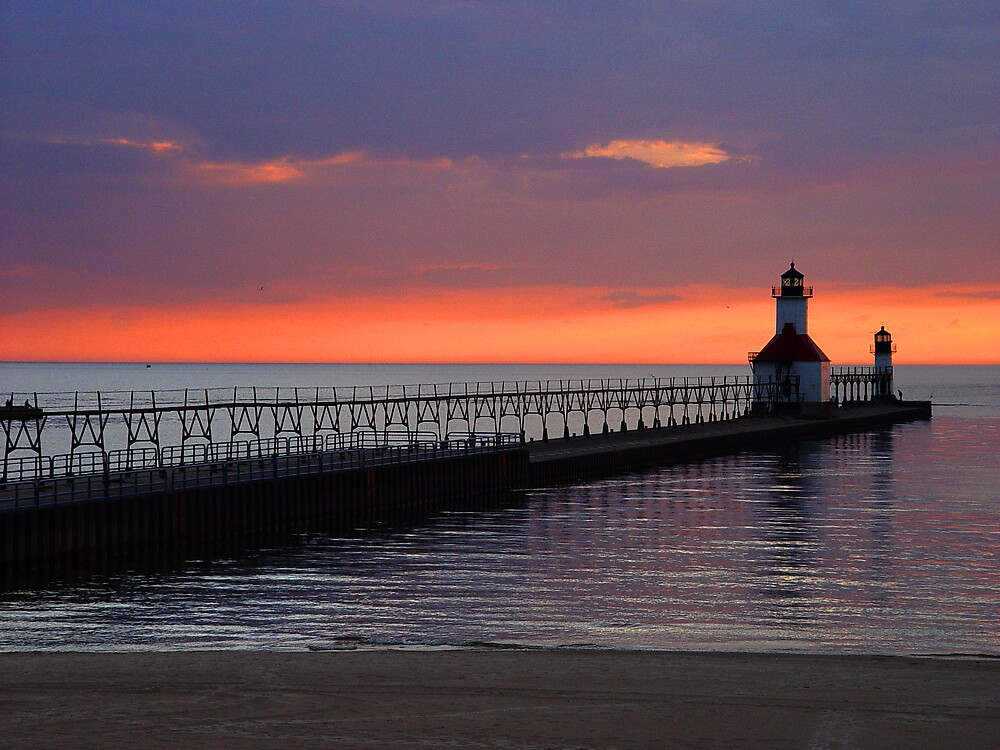 Lighthouse pier Sunset by Dennis Burlingham