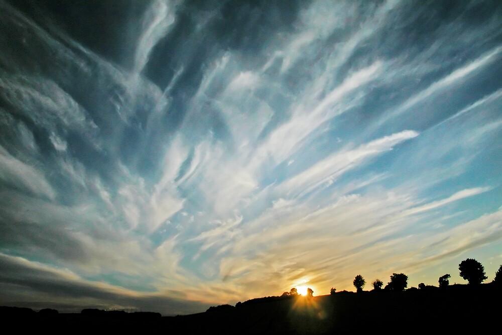 Clouds drift apart by Geoff Spivey