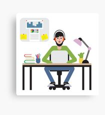 Man sitting at table and working on laptop. Canvas Print