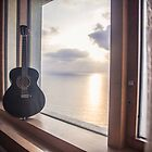 Guitar against the Sunset at Sea by Mohit Sebastian