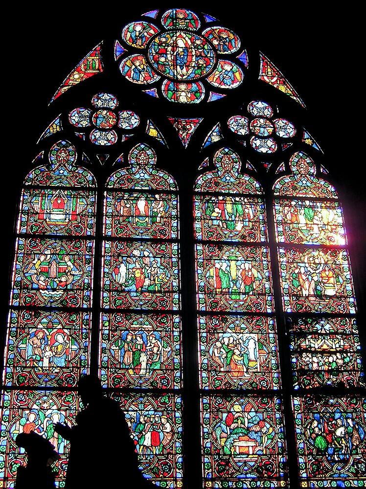 Praying At Notre Dame, Paris by Steve Rhodes