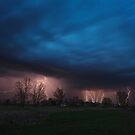 Multiple lightning strikes under dramatic cloudy sky by Lukasz Szczepanski