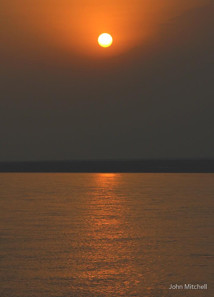 Sunset over the Brahmaputra River, Assam, India by John Mitchell