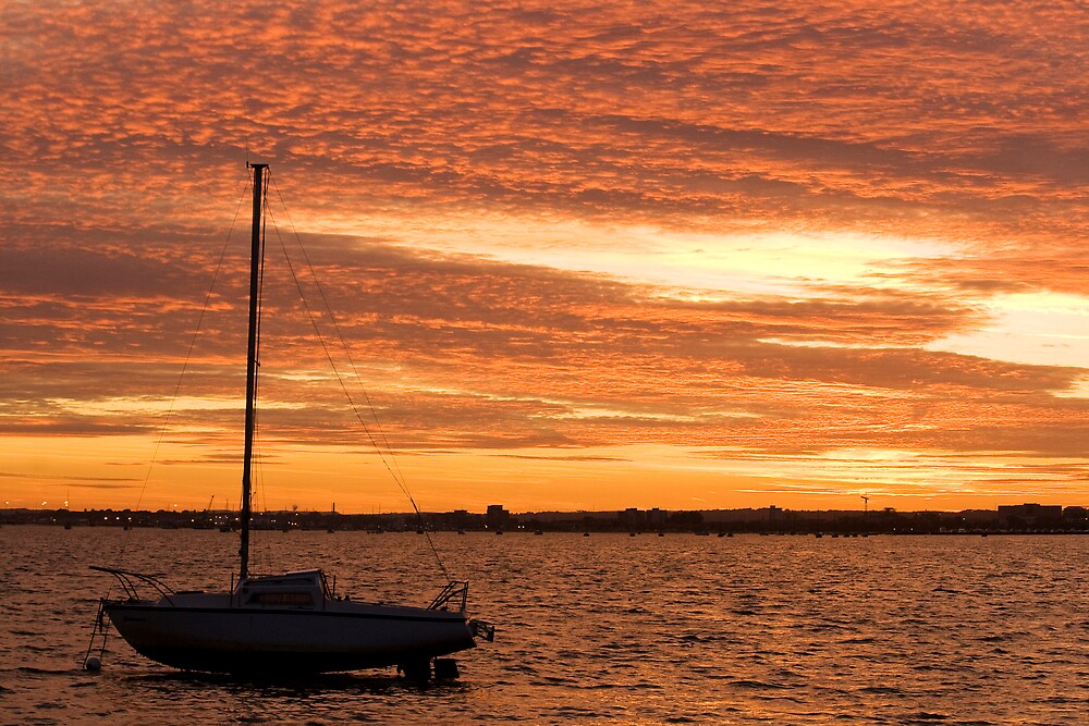 Red sky in Poole Harbour by nathanpwilliams