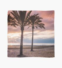 The Sun Rising Between Three Palm Trees on The Beach Scarf