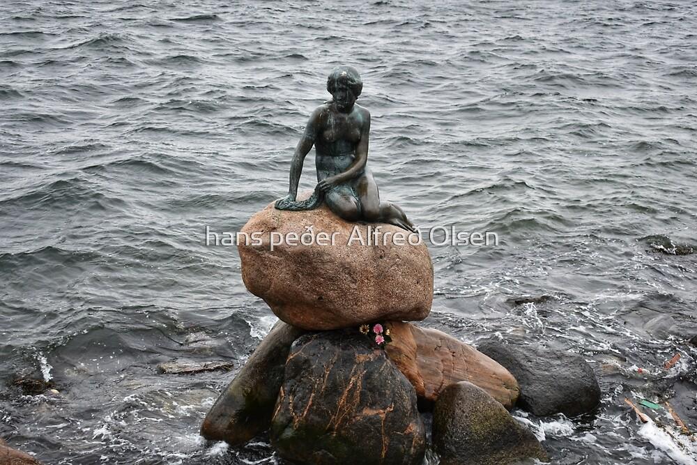 The Little Mermaid, the 1913 statue from  the fairytale of H C Andersen, in Copenhagen Harbour by hans peðer alfreð olsen
