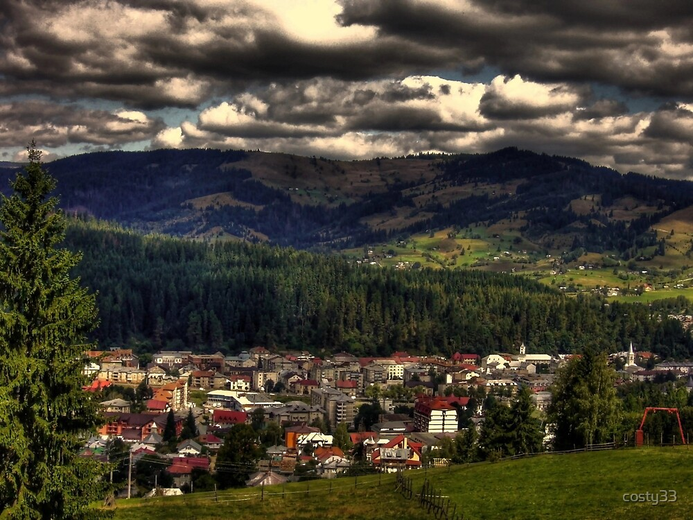 Clouds above  small mountain town by costy33