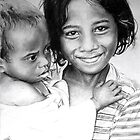 Timori girl and her baby brother by Richie Francis