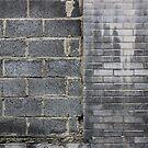 grey brick wall by richman