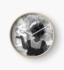 reflected child image Clock