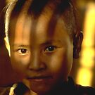 Lahu girl in filtered afternoon light by John Spies